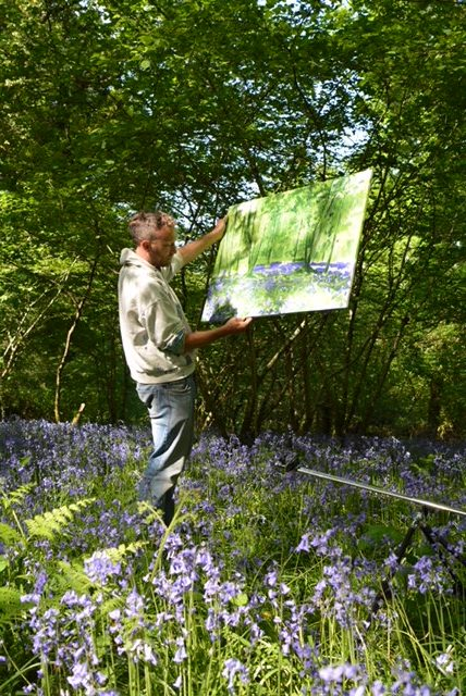 Devon landscape artist Joe Webster painting in Bluebell woodland